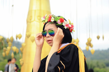 graduate in academic gown