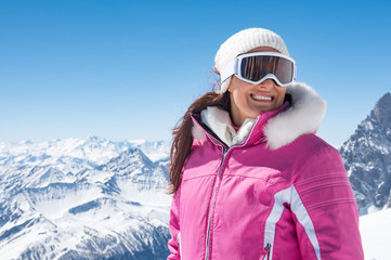 Beautiful skier woman in winter