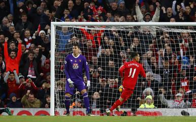 Liverpool's Roberto Firmino celebrates scoring their fourth goal