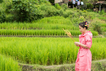 Asian woman relaxing in rice terraces fields on holiday