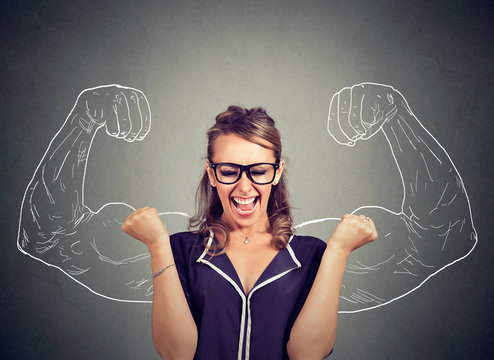happy woman exults pumping fists celebrates success