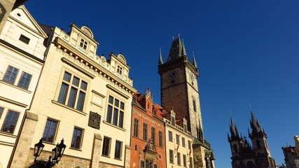 Prague Astronomical Clock and Tyn Church in Old Town Square with blue sky