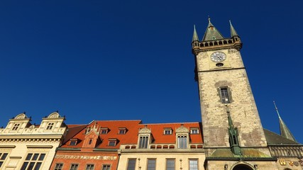 Prague Astronomical Clock tower in Old Town Square with baroque buildings with blue sky