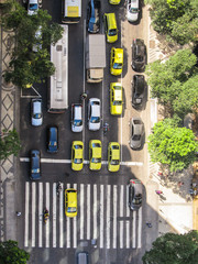 Rio de Janeiro - Circa December 2011: Traffic view from above of a busy street with taxis, bus and motorcycles in Rio de Janeiro
