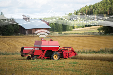 Wall Mural - Self driving combine harvester. Internet of things in agriculture