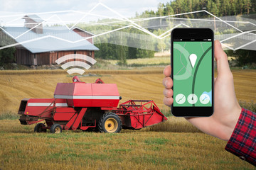 Etiqueta Engomada - Hand with phone. On the screen control interface of the self driving combine harvester. Internet of things in agriculture