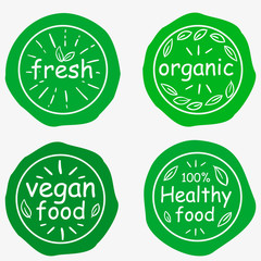Set of four vegetarian labels with lettering. Healthy food stickers.