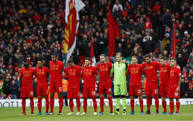 Liverpool players during a minutes silence as part of remembrance commemorations before the match