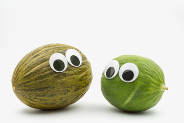 Crazy brown and green melon with googly eyes on white background  - comics ready