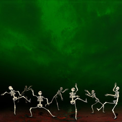 Halloween skeletons. Green background.