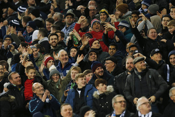 West Brom fans celebrate a goal