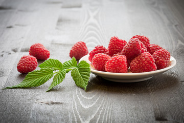 Raspberries on old wooden table