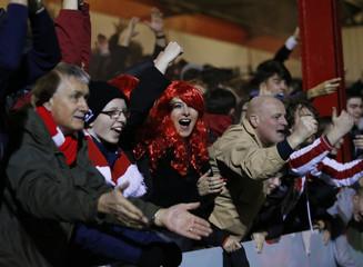 Stourbridge fans celebrate after Jack Duggan scores their first goal
