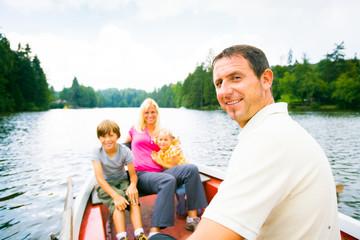 Family Enjoying A Boat Trip