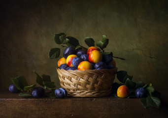 Still life with nectarines and plums