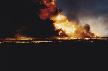 Massive oil well fire in field with oil slick, Kuwait