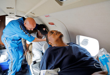 Ill residents of Saint Thomas are assisted on board a medical evacuation plane at Cyril E. King Airport after they were delivered to the airport by the Army's 602nd Area Support Medical Company, in Charlotte Amalie