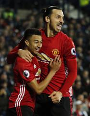 Manchester United's Zlatan Ibrahimovic celebrates scoring their first goal with Jesse Lingard