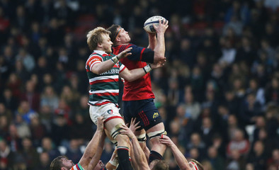 Leicester's Luke Hamilton in action with Munster's Donnacha Ryan