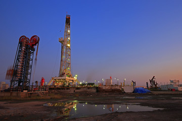 Oil drilling platform in the beautiful night