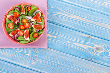 Fresh fruit and vegetable salad, healthy nutrition concept, copy space for text on boards