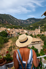 Europe Spain travel vacation. Happy woman in sun hat enjoying at view on village in the Tramuntana mountains. Amazing view