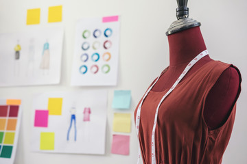 Red dummy with measuring tape in tailors studio, Creative Design and Artistic Concept