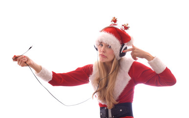 A young girl dresses up as Santa Claus and wants to hear Christmas music. She wears headphones on her head and notices that she has no power and no music.