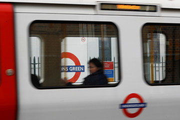 A passenger sits on an underground train leaving Parson's Green station after it reopened following an explosion on a rush hour train yesterday morning, in London
