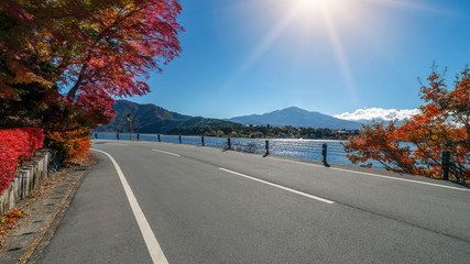 Road Scenery with Lake and Mountain Landscape
