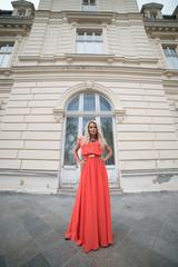 portrait of a beautiful blonde near castle