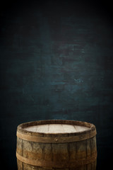 Wall Mural - background of barrel and worn old table of wood.