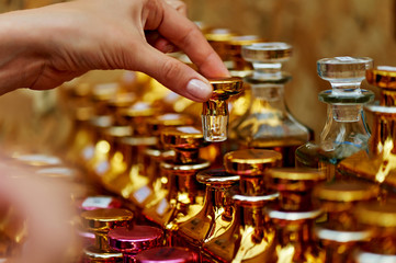 Glass perfume bottles based oils. A Bazaar, market. Macro. Gold and pink gamma