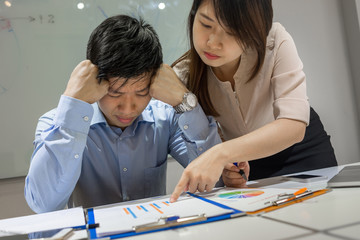 Asian businessman feels tired, exhausted because of many problems