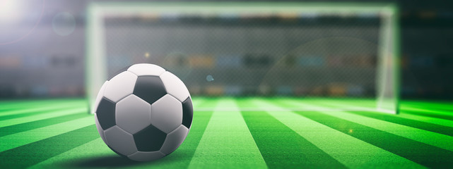 Soccer ball on an illuminated field grass background. 3d illustration