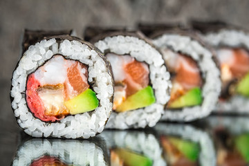 Photo sur Aluminium Sushi bar Sushi roll with salmon, shrimps and avocado