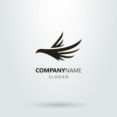 Black and white abstract logo flying bird