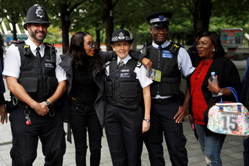 Cressida Dick, the Metropolitan Police Commissioner stops to pose for photographs with people as she walks along the Southbank in London