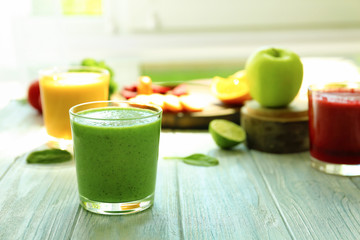 Glass of fresh smoothie on table