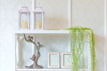 White wooden shelves with picture frames and candle interior decoration contemporary