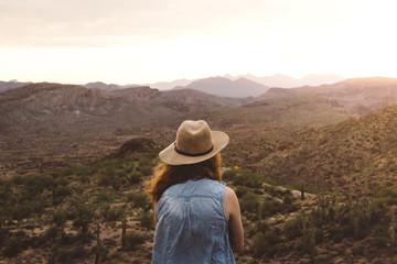 Girl Watching A Mountain Sunset  Fotoväggar