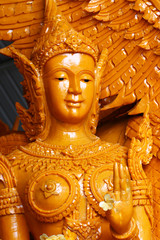 closeup yellowish Candle statue of lady angel, one of the sculpture on parade of Thailand's annual buddhism traditional festival, hand made carving, artist crafting product for graphic designer,