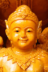 closeup yellowish Candle statue of child angel, one of the sculpture on parade of Thailand's annual buddhism traditional festival, hand made carving, artist crafting product for graphic designer,