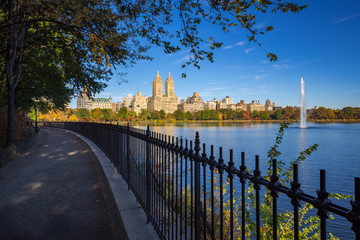 Upper West Side buildings,  Central Park and the Jacqueline Kennedy Onassis Reservoir with fountain in Fall. Manhattan, New York City