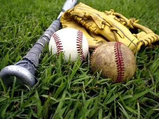 Baseball gloves, baseball and a baseball bat