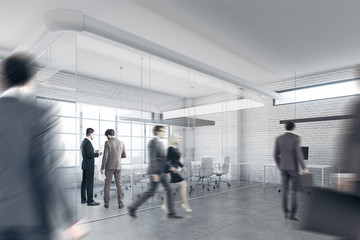 White brick office with a reception, people