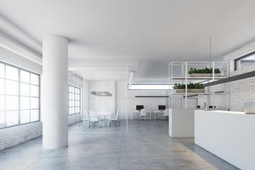White brick wall office, white reception desk side
