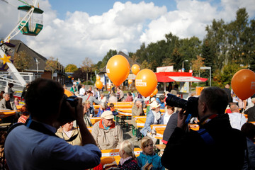 Photographers take pictures of balloons during election rally in Stralsund