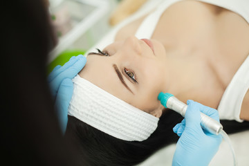 Cosmetology. Ultrasonic face cleaning, peeling, in a beauty salon