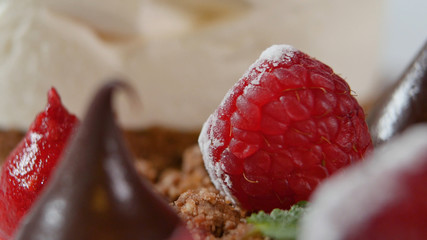 Close up of strawberry and chocolate spread. Chocolate drop and strawberries closeup